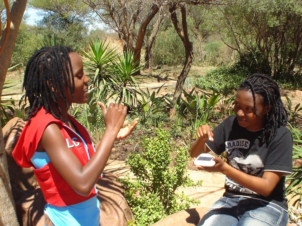 100 Under $100 Picture of the Week: Solar Ear Designers Discussing their Solar Charger in Botswana